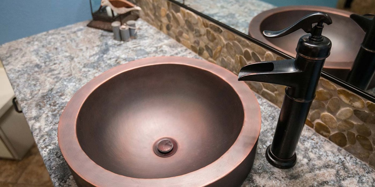 copper sink and faucet with granite counter top